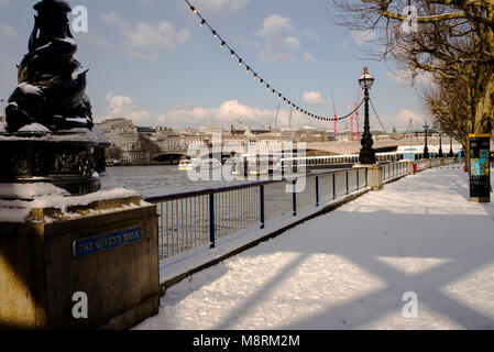 The Queens walk' southbank river Thames after snow fall London UK - Stock Photo