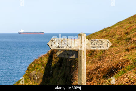 A wooden signpost saying 'Coast path', 'Public Footpath', 'Cadgwith 1 3/4 m' and 'Lizard Point 2m' Lizard Peninsula, - Stock Photo