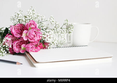 Styled stock photo. Closeup of wedding bouquet made of pink roses and baby's breath, Gypsophila flowers lying on - Stock Photo