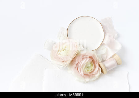 Feminine wedding, birthday desktop mock-up scene. Porcelain plate, blank craft paper greeting cards, silk ribbon, - Stock Photo