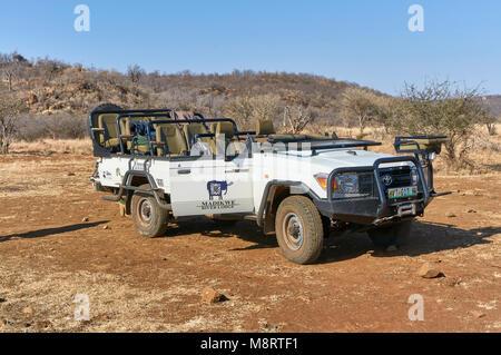 One of the modified Toyota Land cruiser Safari vehicles that take Tourists to Madikwe Game reserve on Safari Drives. - Stock Photo