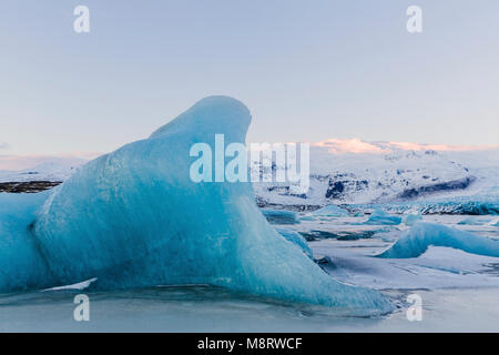 Tranquil view of icebergs in frozen lake during winter - Stock Photo