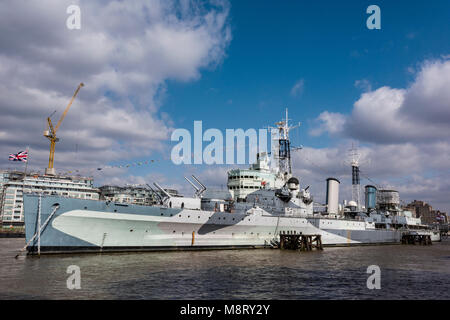 the second world war battleship or battle cruiser HMS Belfast part of the imperial war museum dressed overall celebrating - Stock Photo