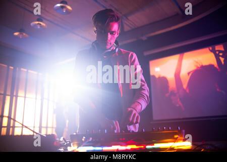 Handsome DJ Focused on Work - Stock Photo