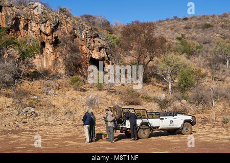 A stop on an early morning safari at Madikwe Game Reserve, so that Tourists can have early morning refreshments. - Stock Photo