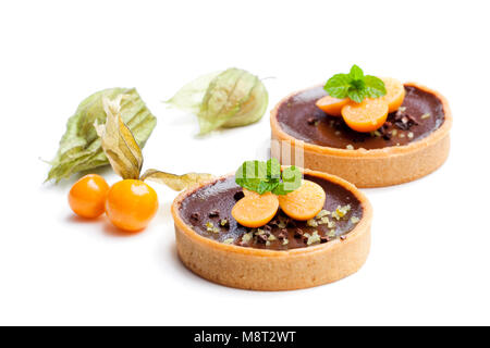 mini  chocolate tarts with fresh physalis isolated on white - Stock Photo