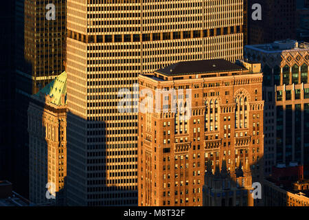 Aerial view at sunset of the Lincoln Building and the MetLife Building skyscrapers. Midtown Manhattan, New York - Stock Photo