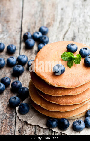 Stack  of scotch pancakes with fresh blueberry on wooden table - Stock Photo