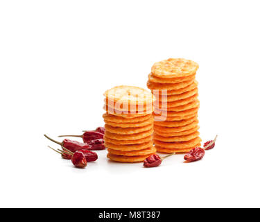 Round  shape rice cracker with chili pepper isolated on white - Stock Photo