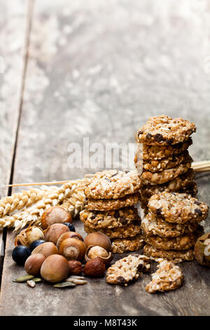 Healthy  protein granola crackers with seeds and nuts on wooden table - Stock Photo