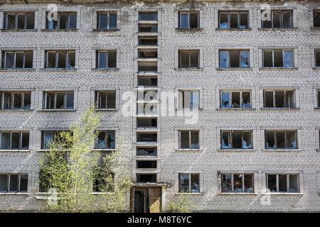 Abandoned and ruined apartment house in Skrunda, Latvia - Stock Photo
