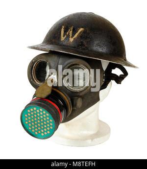 WW2 British ARP (Air Raid Precaution) Warden gas mask and helmet - Stock Photo