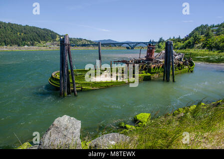 Wreck of the Mary D. Hume in the Rogue River, Gold Beach, Oregon - Stock Photo