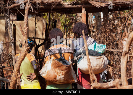Women at the Key Afer market. At the weekly market you can exchange food, animals and things but also information, - Stock Photo