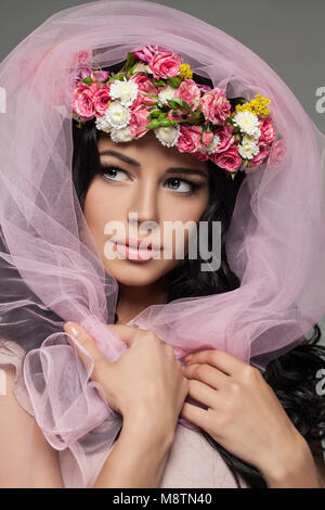Beautiful Girl with Spring Flowers and Pink Cloth. Closeup Portrait - Stock Photo