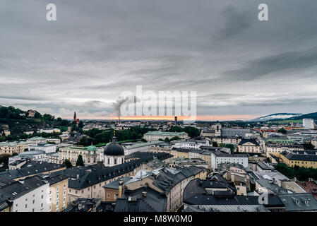 Cityscape of Salzburg from Kapuzinerberg Hill at sunset - Stock Photo
