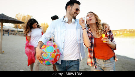 Group of young cheerful people bonding to each other and smiling - Stock Photo