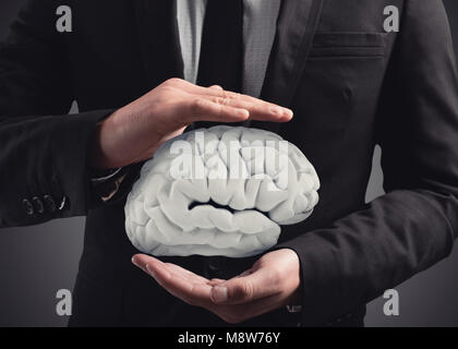 Man protects a brain with his hands. 3D Rendering - Stock Photo