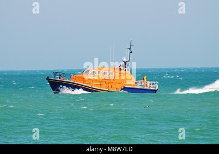 RNLI Eastbourne lifeboat Diamond Jubilee on patrol during the Airbourne airshow at Eastbourne, East Sussex, England - Stock Photo