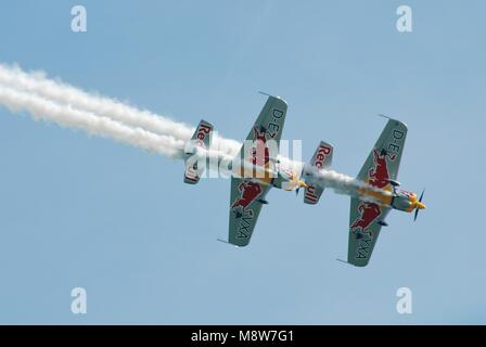 Aerobatic display team The Red Bull Matadors perform at the Airbourne airshow at Eastbourne in East Sussex, England - Stock Photo