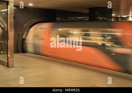 Train travelling through Partick Subway station, Glasgow, Scotland - Stock Photo