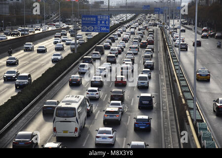 Beijing, Beijing, China. 20th Mar, 2018. Beijing, CHINA-20th March 2018: Cars run slowly due to traffic jam in Beijing. - Stock Photo