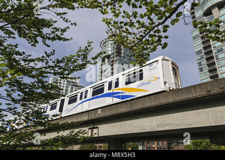 Vancouver, British Columbia, Canada. 1st May, 2014. SkyTrain light rapid transit cars on a section of elevated track - Stock Photo