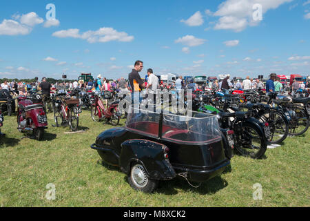 People looking at the old, vintage motorbikes with sidecars at the Gloucestershire Vintage Country Show in Cirencester - Stock Photo