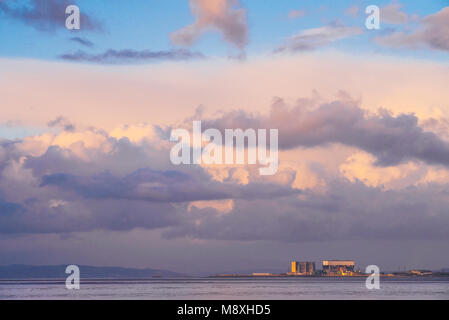 Clouds over the nuclear power stations at Heysham, Lancashire, in evening light - Stock Photo