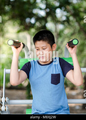 Asian boy with exercise equipment outdoor - Stock Photo