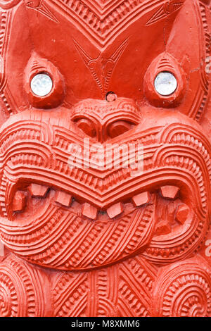 new zealand rotorua new zealand whakarewarewa red maori carving  mother of pearl decoration the meeting house wahiao - Stock Photo