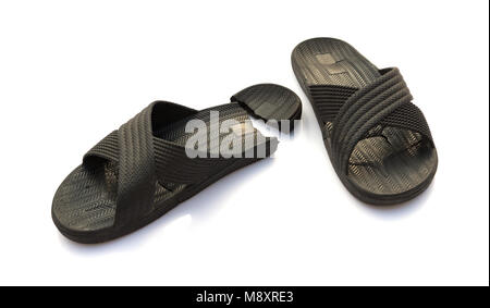 pair of badly worn out slippers on white - Stock Photo