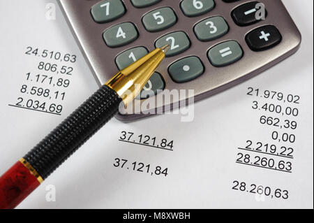financial invoice with calculator and pen - Stock Photo