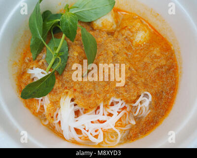 Delicious Rice Noodles with Fish Curry Sauce and Fish Balls - Stock Photo