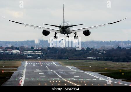 Qatar Airways Boeing 787 Dreamliner landing at Birmingham Airport, UK (A7-BCV) - Stock Photo