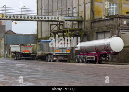 18 March 2018 Heavy goods Vehicle articulated trailers parked up on Kennedy Wharf in Cork Harbour Ireland on a snowy - Stock Photo