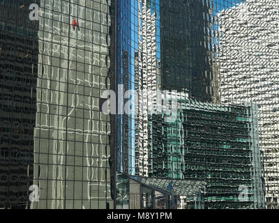 abstract image of Chicago buildings reflected in glass - Stock Photo