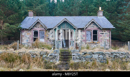 An old derelict stone Victorian Style Cottage beside Loch Lee in the Forests of Glen Esk in the Angus Glens, Scotland. - Stock Photo