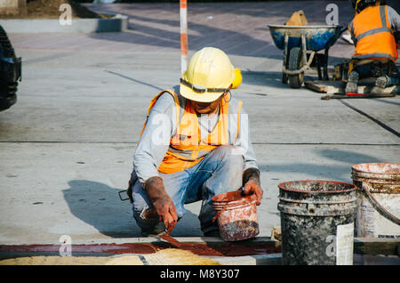 Builder of sidewalks in ravine, Lima - Peru - Stock Photo