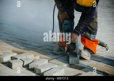 Builder of sidewalks in ravine, Lima - Peru - Stock Photo