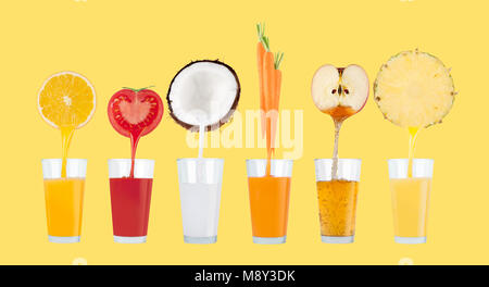 Fresh juice pours from fruits and vegetables in a glass on pastel yellow background - Stock Photo