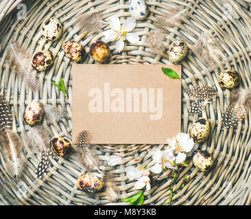 Natural colored quail eggs for Easter in basket - Stock Photo