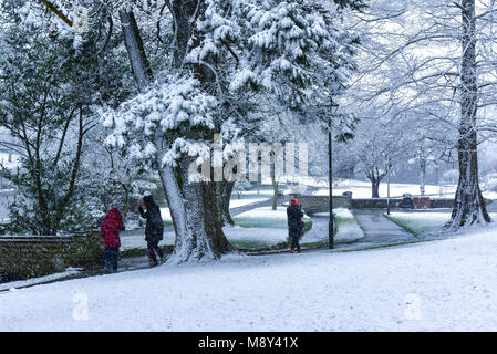 People enjoying the heavy snow fall on Trenance Gardens in Newquay Cornwall. - Stock Photo