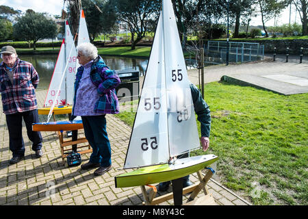 Model yachts belonging to members of the Newquay Model yacht Club at Trenance Lake in Newquay Cornwall. - Stock Photo