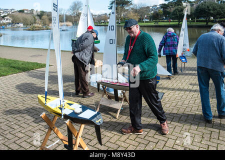 Members of the Newquay Model yacht Club at Trenance Lake in Newquay Cornwall. - Stock Photo