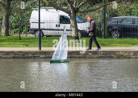 A member of the Newquay Model Yacht Club at Trenance Boating Lake controlling his model racing yacht Newquay Cornwall. - Stock Photo