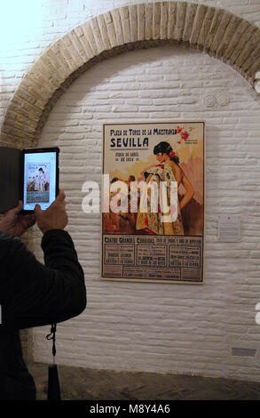 Tourist taking a photo in the museum at Plaza de Toros in Seville - Stock Photo