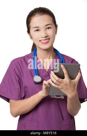 Beautiful Asian American doctor or nurse using a tablet computer with stethoscope isolated on white background - Stock Photo
