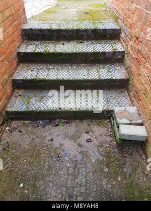 Steps leading from alleyway to path - Stock Photo