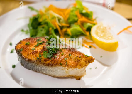 Salmon Steak with Vegetable, served on plate in the restaurant - Stock Photo